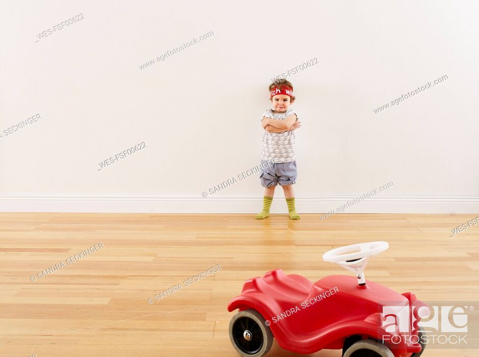 Stock Photo: Little girl playing with pedal car.