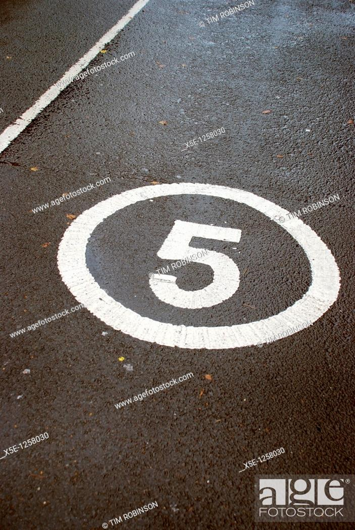 Stock Photo: Figure 5 in a circle painted on roadway.