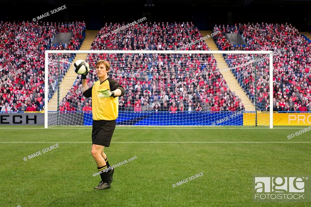 Stock Photo: Goalkeeper throwing football.