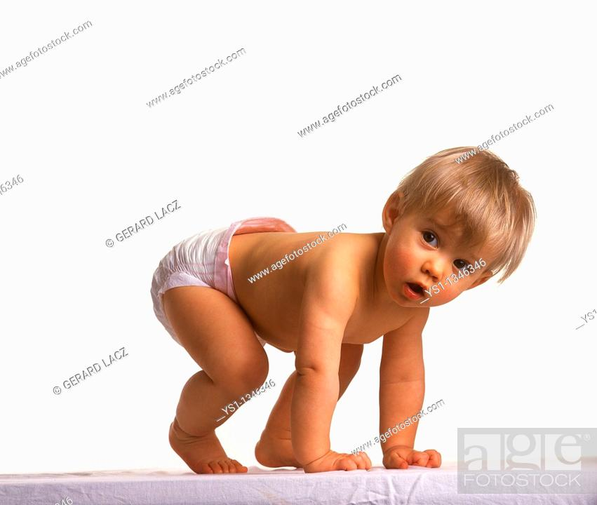 Stock Photo: BABY GIRL AGAINST WHITE BACKGROUND.