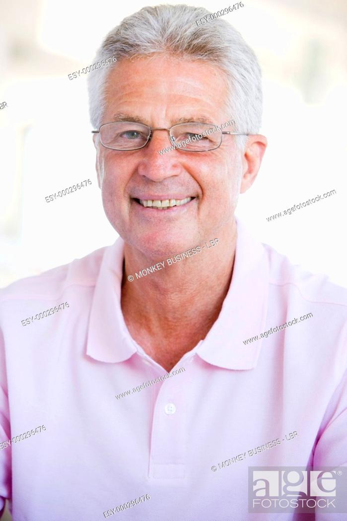 Stock Photo: Man Looking Through New Glasses.