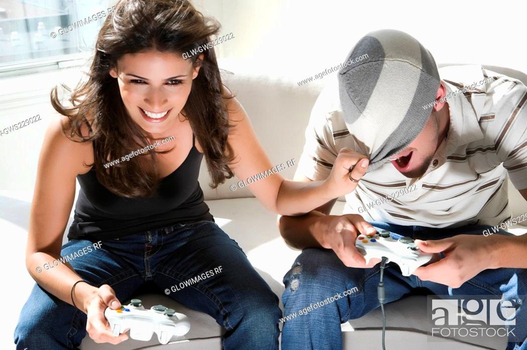 Stock Photo: High angle view of a young couple playing video game.