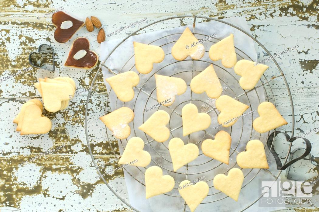 Stock Photo: Heart-shaped Christmas cookies on baking grid.
