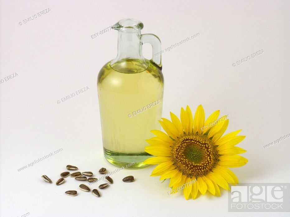Stock Photo: Sunflower oil and seeds.
