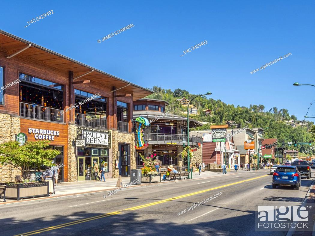 Stock Photo: Parkway road though downtown in the Great Smoky Mountains resort town of Gatlinburg Tennessee in the United States.