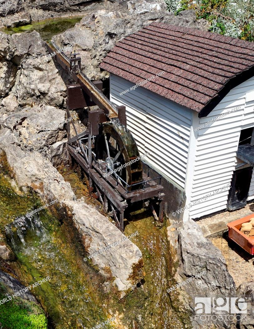 Stock Photo: Water mill for grinding corn, from the Bekonscot Model Village, in Beaconsfield, Buckinghamshire, England, is the oldest original model village in the world.