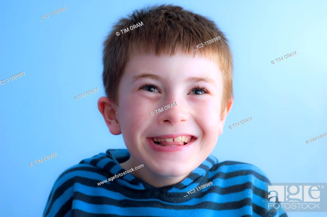 Stock Photo: A  picture of a ten year old boy laughing in his bedroom in the Uk.