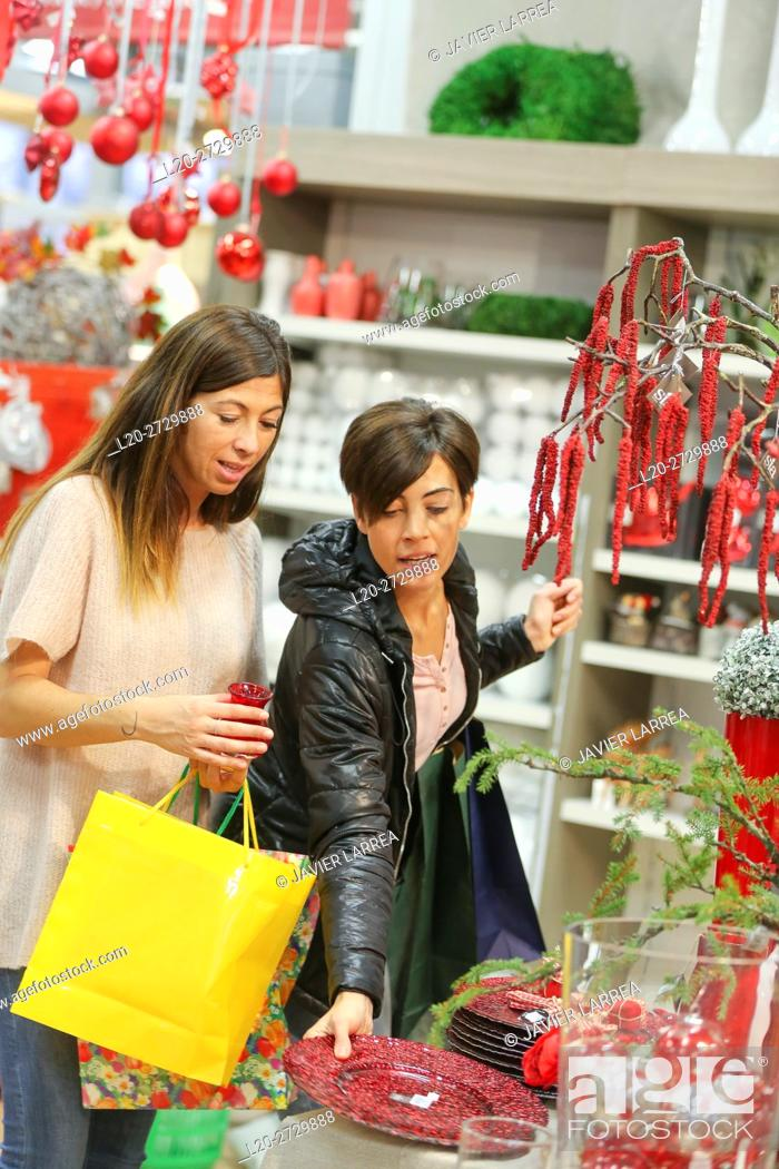 Stock Photo: Women buying Christmas ornaments in garden center.