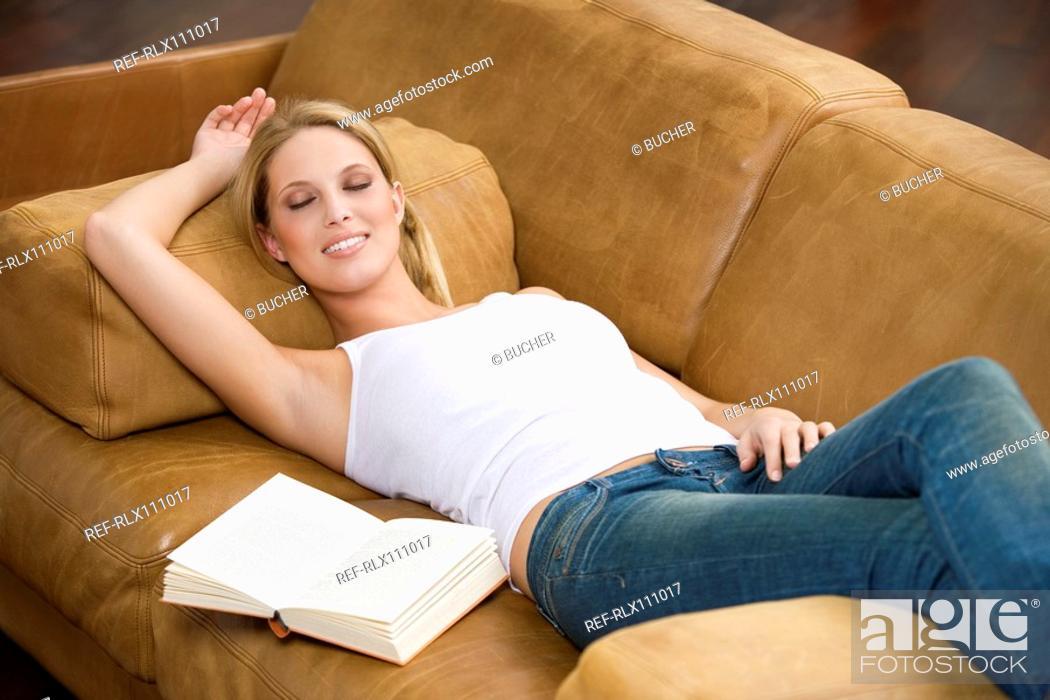 Stock Photo: Young woman sleeping on sofa.