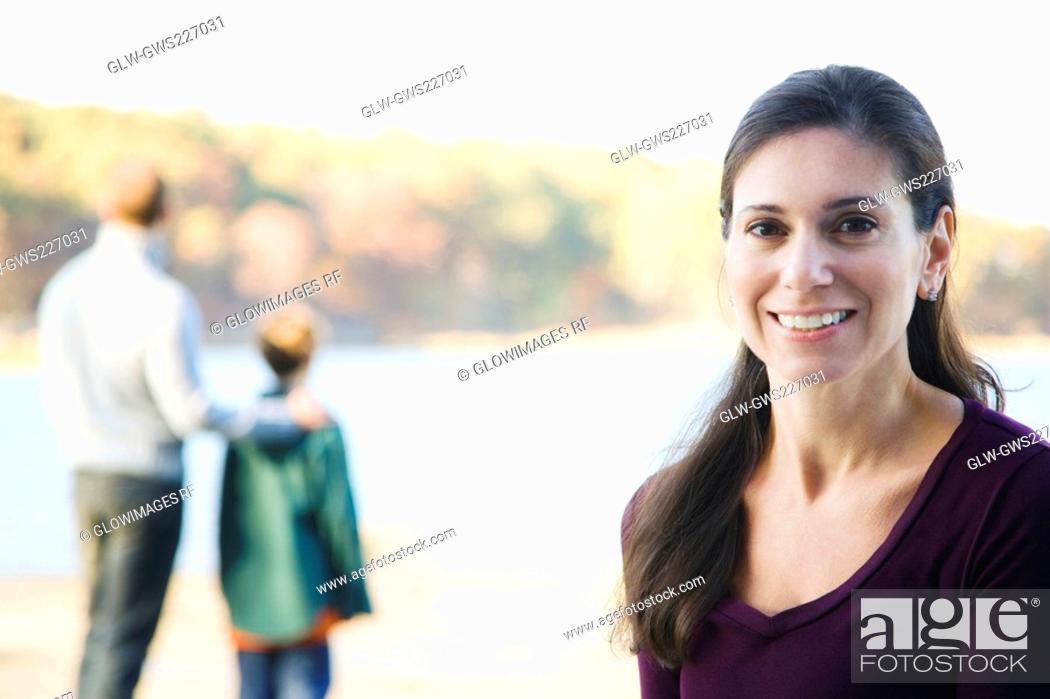 Stock Photo: Portrait of a mid adult woman smiling.