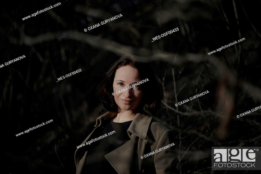 Stock Photo: Beautiful mature woman standing in forest.