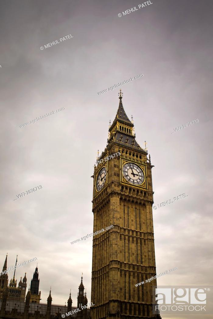 Stock Photo: Big Ben - London at dusk on a cloudy day. Big Ben, or the Elizabeth Tower as it is also known, was built in the 19 Century after the Palce of Westminster was.