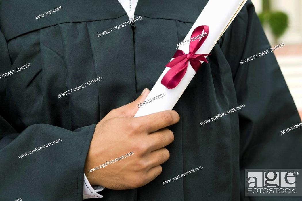 Stock Photo: Graduate Holding Diploma mid section.