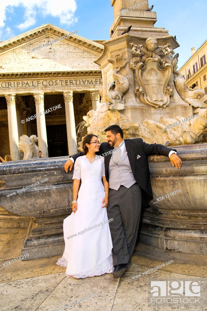 Stock Photo: Bride and groom at Pantheon fountain in Rome, Italy.