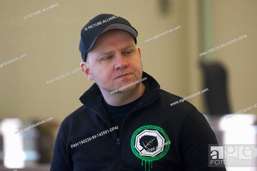 Stock Photo: 26 February 2019, Rhineland-Palatinate, Koblenz: Sven Skoda, one of the defendants, is waiting in the courtroom of the Regional Court for the start of the.