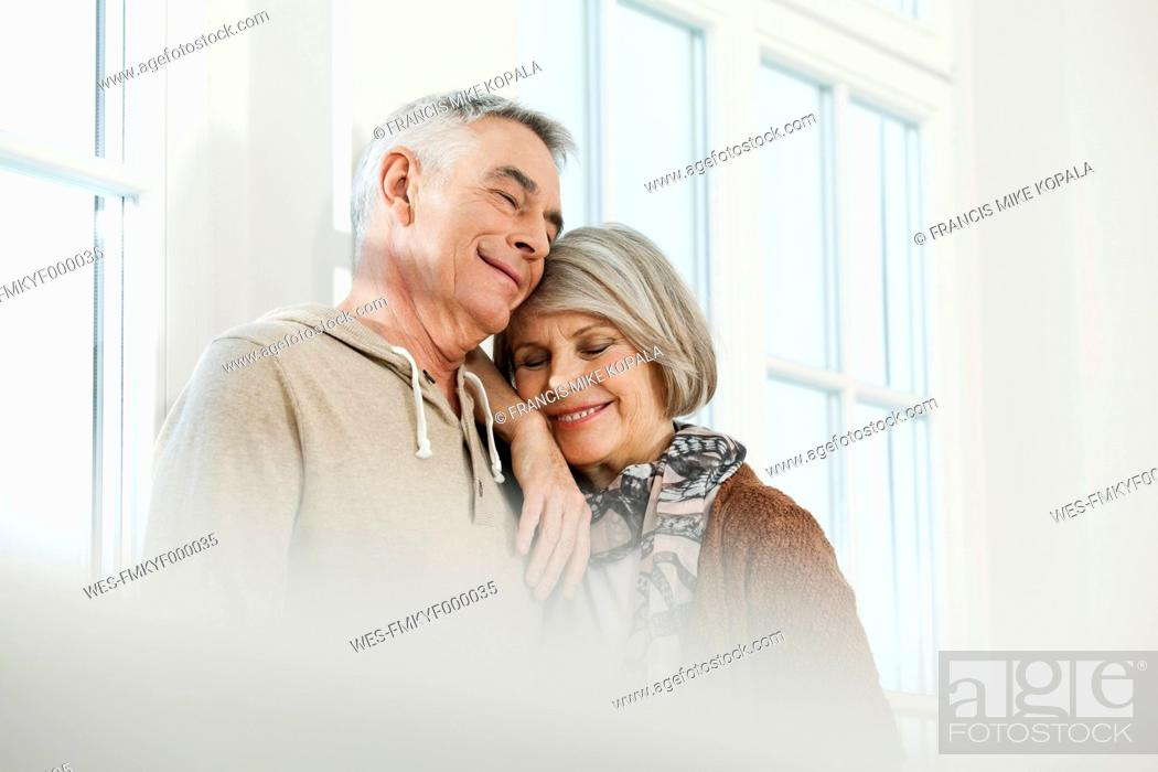 Stock Photo: Germany, Berlin, Senior couple smiling.