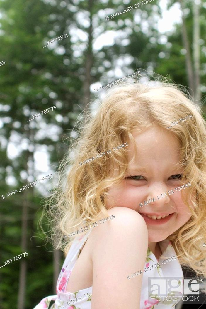 Stock Photo: Cute girl smiling at the camera.