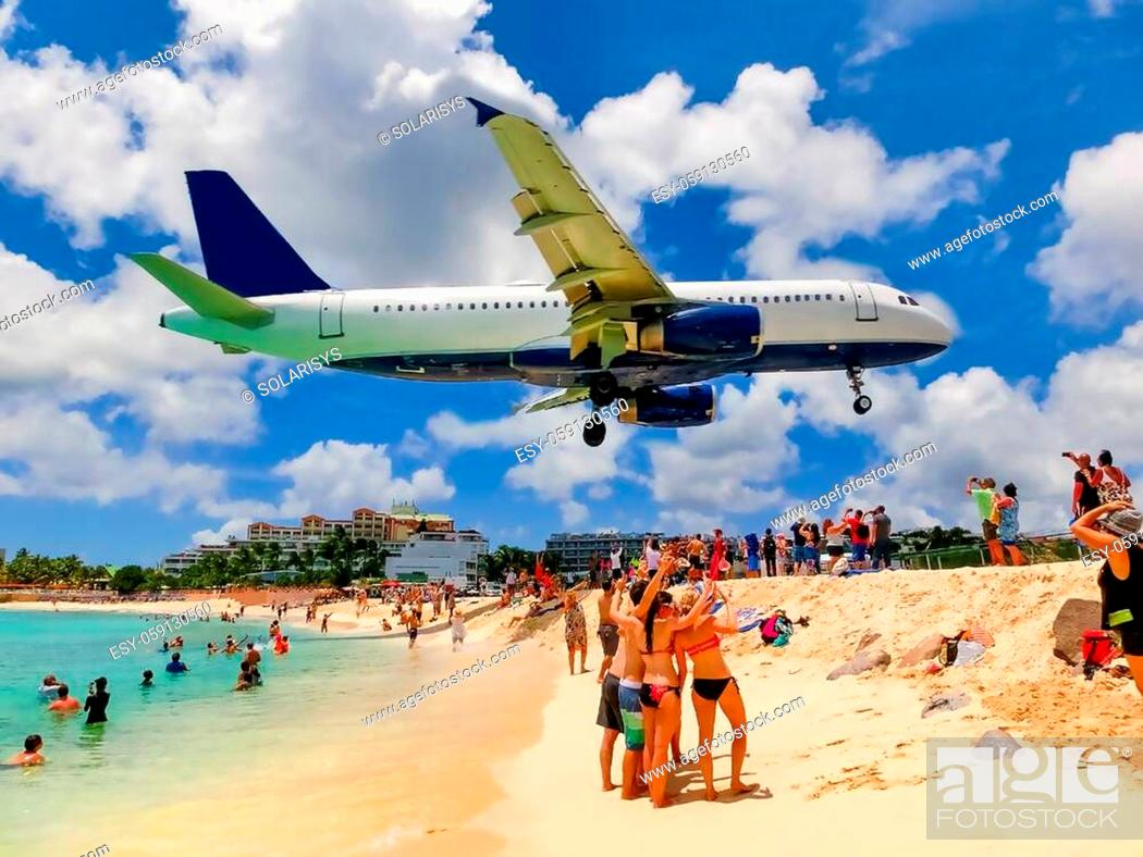 Stock Photo: The people making photos at Maho Bay beach. It is one of the world's premier planespotting destinations.