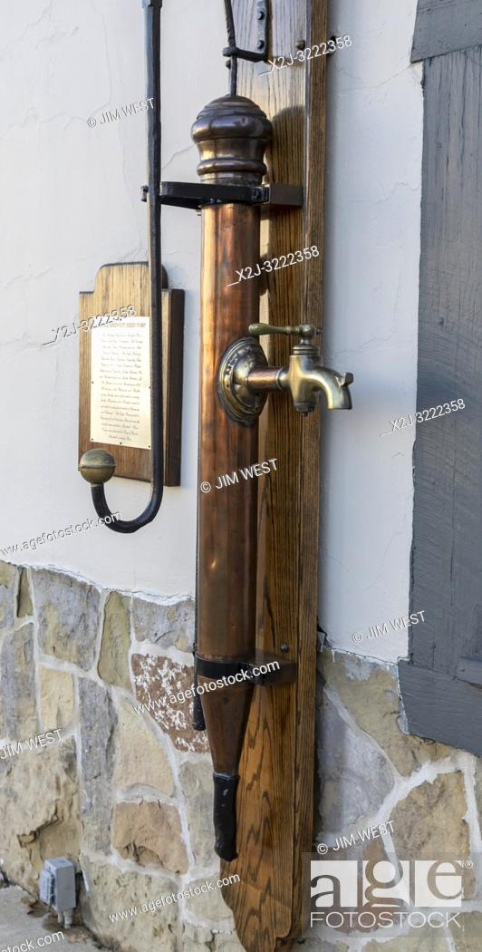 Stock Photo: Marshall, Michigan - A beer pump from the old Eagle Brewery, on display outside Schuler's restaurant.