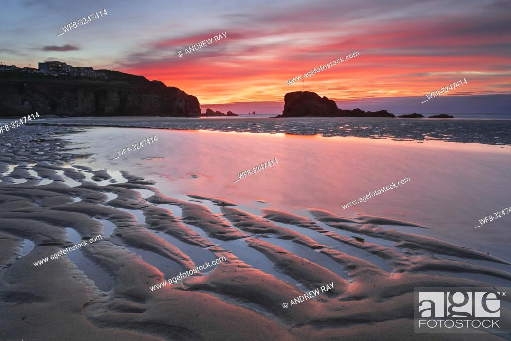 Stock Photo: Sand ripples captured at sunrise on the beach at Perranporth on the north coast of Cornwall, with Chapel Rock in the distance.