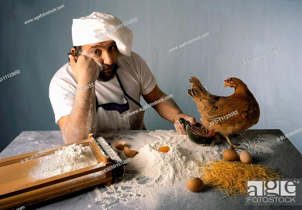 Stock Photo: A chef waiting with a chicken.