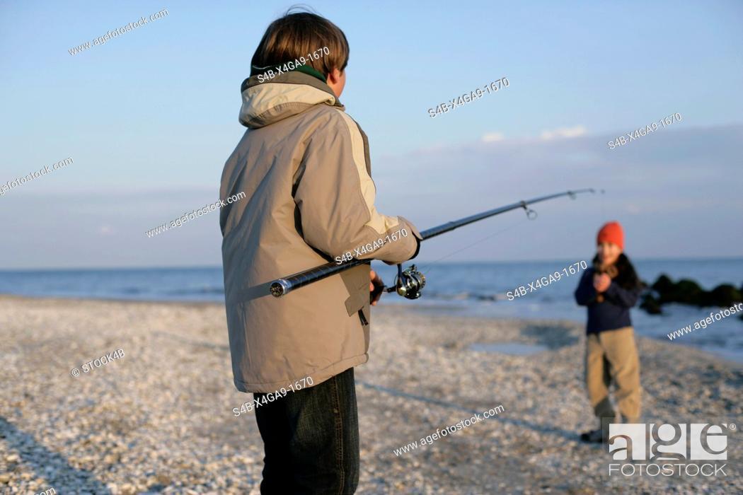 Stock Photo: Boy holding a fishing rod.