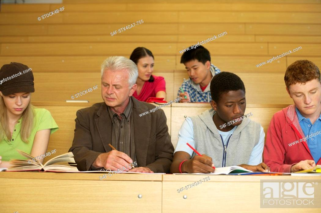 Stock Photo: Students and professor in a lecture auditorium.