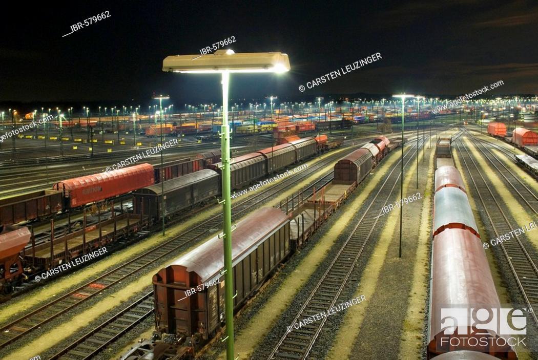 Stock Photo: Parked freight trains at Maschen railroad shunting yard near Hamburg at night, Lower Saxony, Germany.