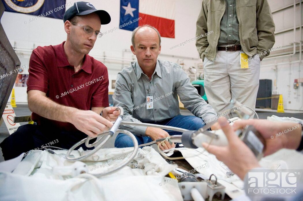 Stock Photo: Astronaut Jeffrey Williams (center), Expedition 21 flight engineer and Expedition 22 commander, participates in a 1-G extravehicular activity (EVA) training.