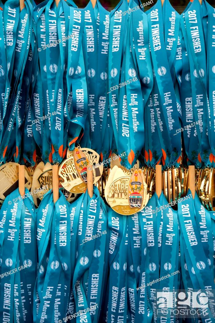 Stock Photo: Gold medallions on neck ribbons for runners completing a half marathon in Huntington Beach, CA, are on display before the race.