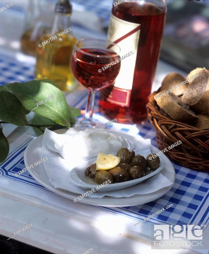 Stock Photo: Green olives with aioli and wine.