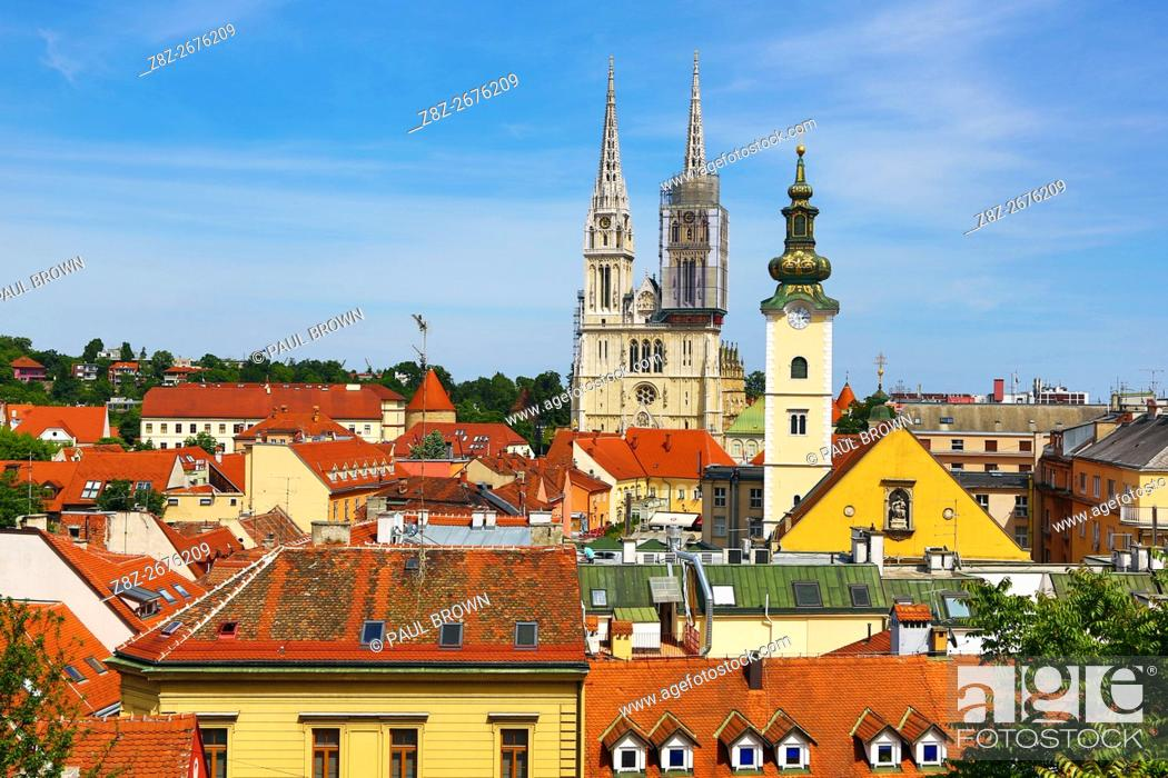 Stock Photo: General city skyline view of Zagreb Cathedral with tower renovation and the tower of St. Mary's Church in Zagreb, Croatia.