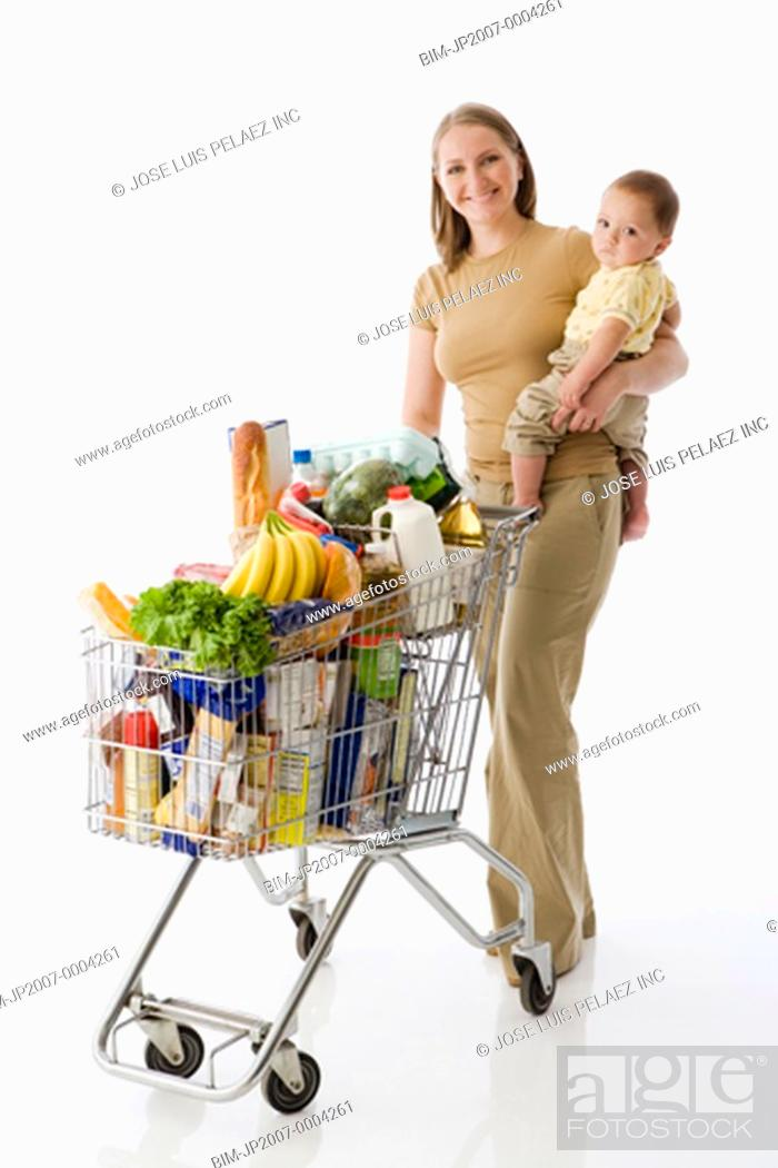 b6f0977fd Russian mother holding baby and grocery shopping, Stock Photo ...