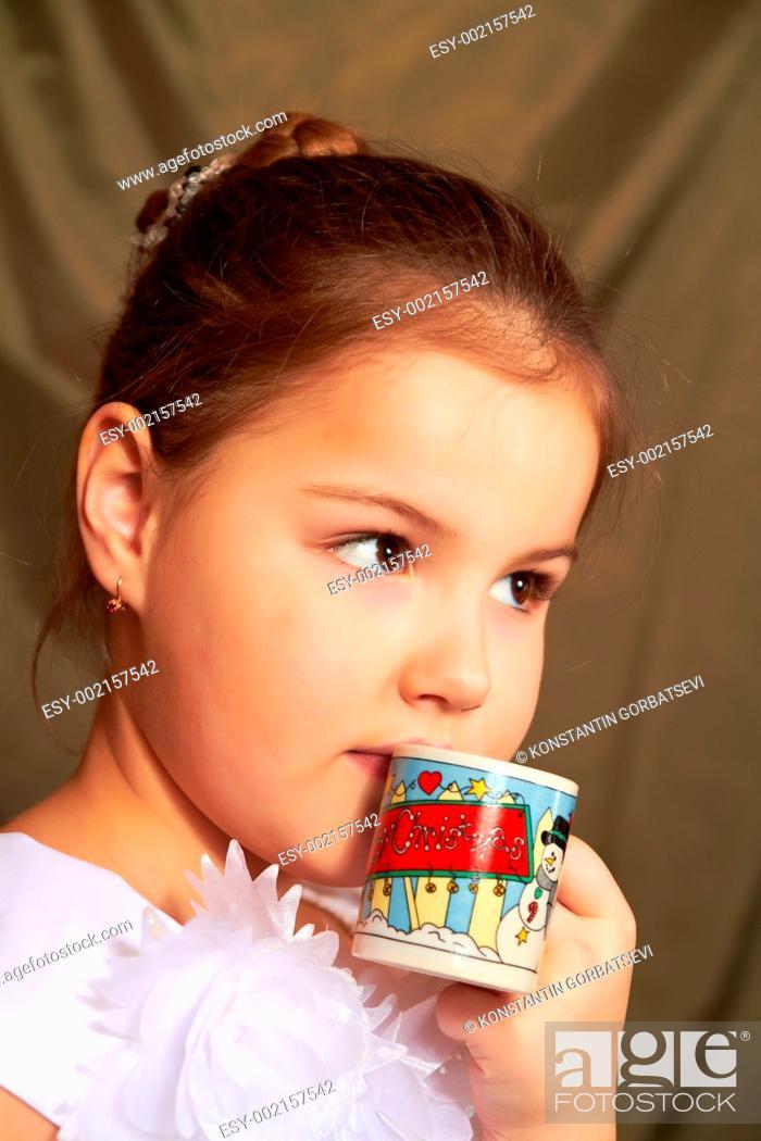 Stock Photo: Little girl drinks.