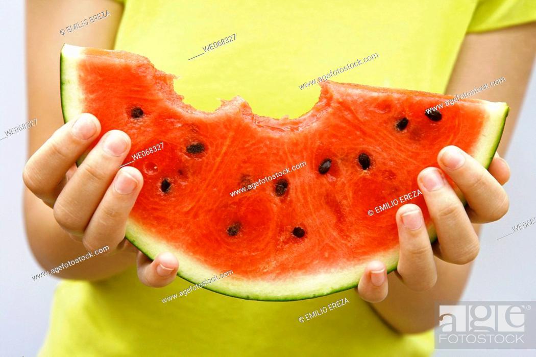 Stock Photo: Woman holding watermelon.