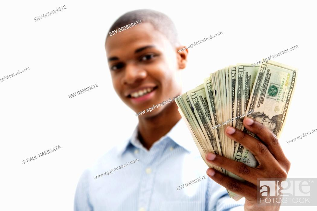 Stock Photo: African man smiling and holding money, isolated.