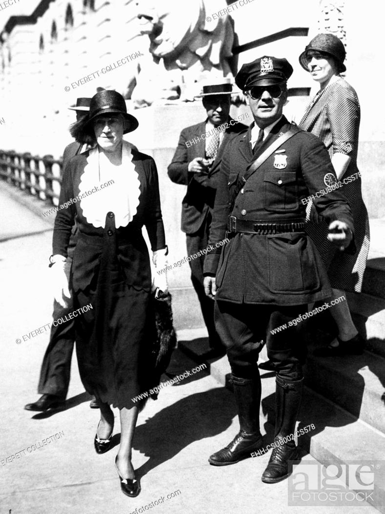Stock Photo: Mrs. Evelyn Menken, New York Socialite, leaving police headquarters. June 16, 1931. Three thieves broke into her home, bound and gagged her and stole $200.