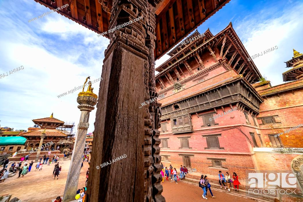 Stock Photo: Kathmandu, Nepal - September 21 2019: People walking around Patan Durbar Square, a UNESCO Heritage site in Nepal. Temples reconstruction after Earthquake.