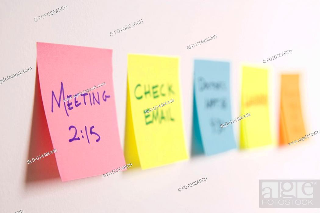 Stock Photo: Sticky notes of to do list on wall.