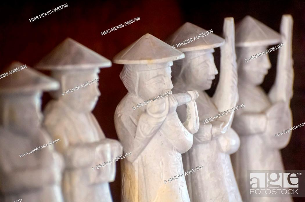Stock Photo: Vietnam, High Tonkin, province of Lao Cai, Sa Pa town, traditional musicians statuettes of a sculptor craftsman in his workshop.