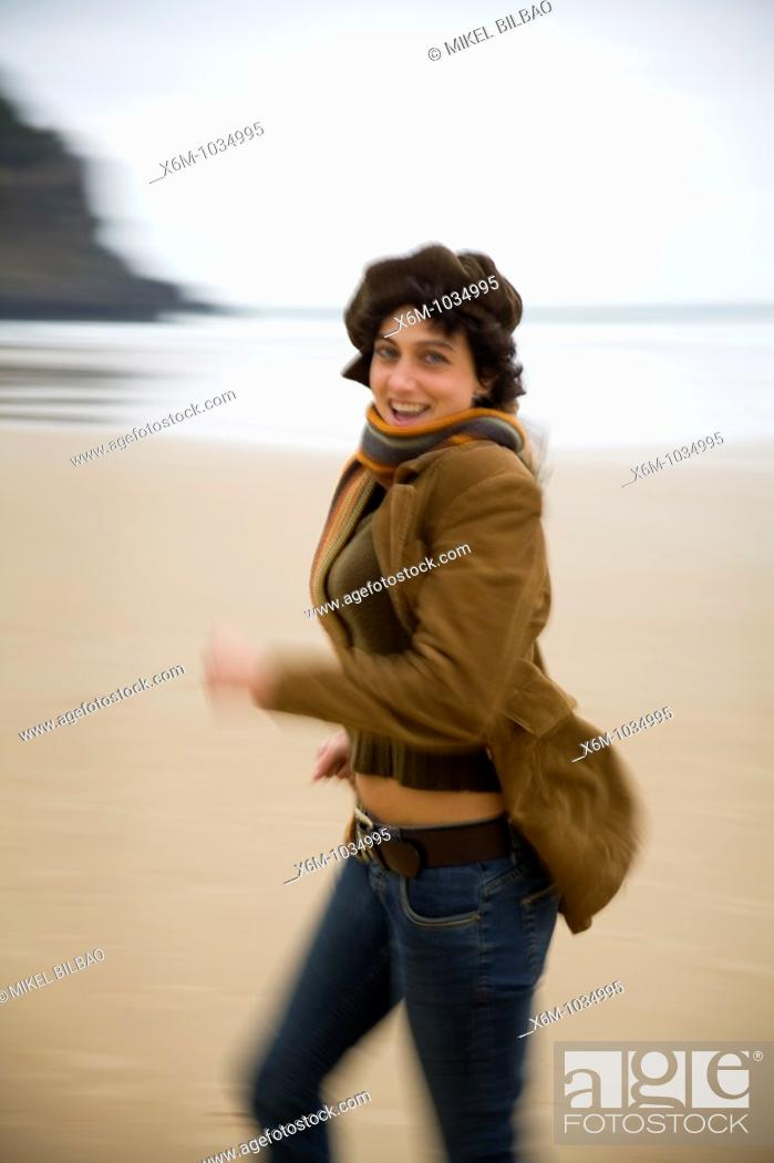 Stock Photo: young woman portrait in a beach.