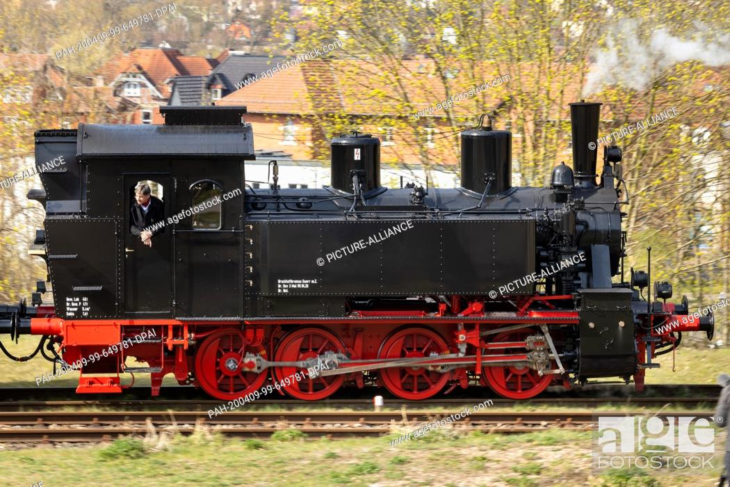 Stock Photo: 09 April 2020, Thuringia, Meiningen: The newly repaired steam locomotive 99 886 of the Rhön train, which was severely damaged in an accident in the summer of.