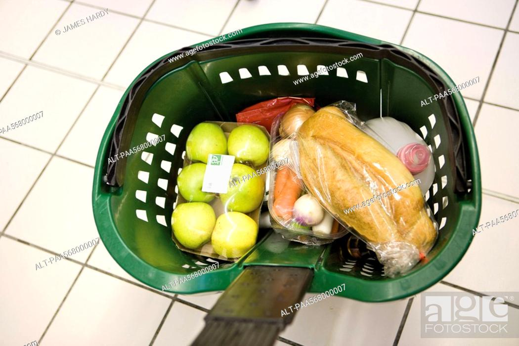 Stock Photo: Shopping basket containing groceries.