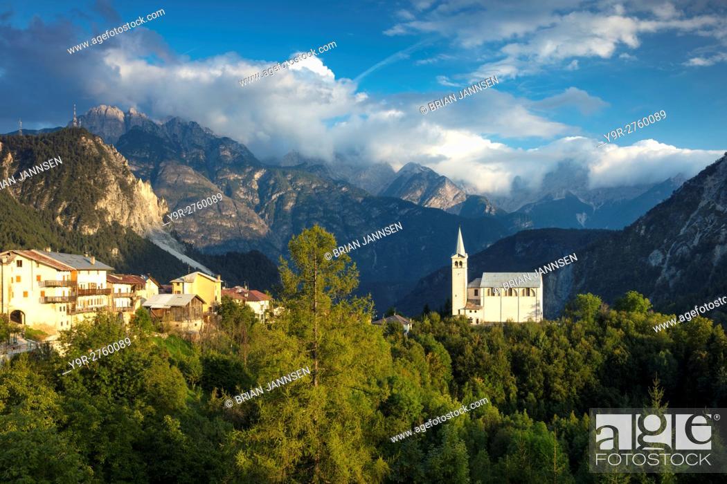 Stock Photo: Evening sunlight over Chiesa di San Martino and the Dolomite Mountains near Venas di Cadore, Veneto, Italy.