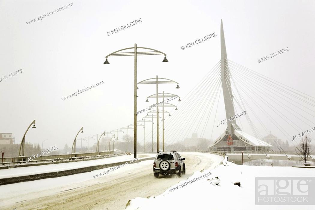 Stock Photo: Jeep driving over the Esplanade Riel Bridge, Winnipeg, Manitoba, Canada.