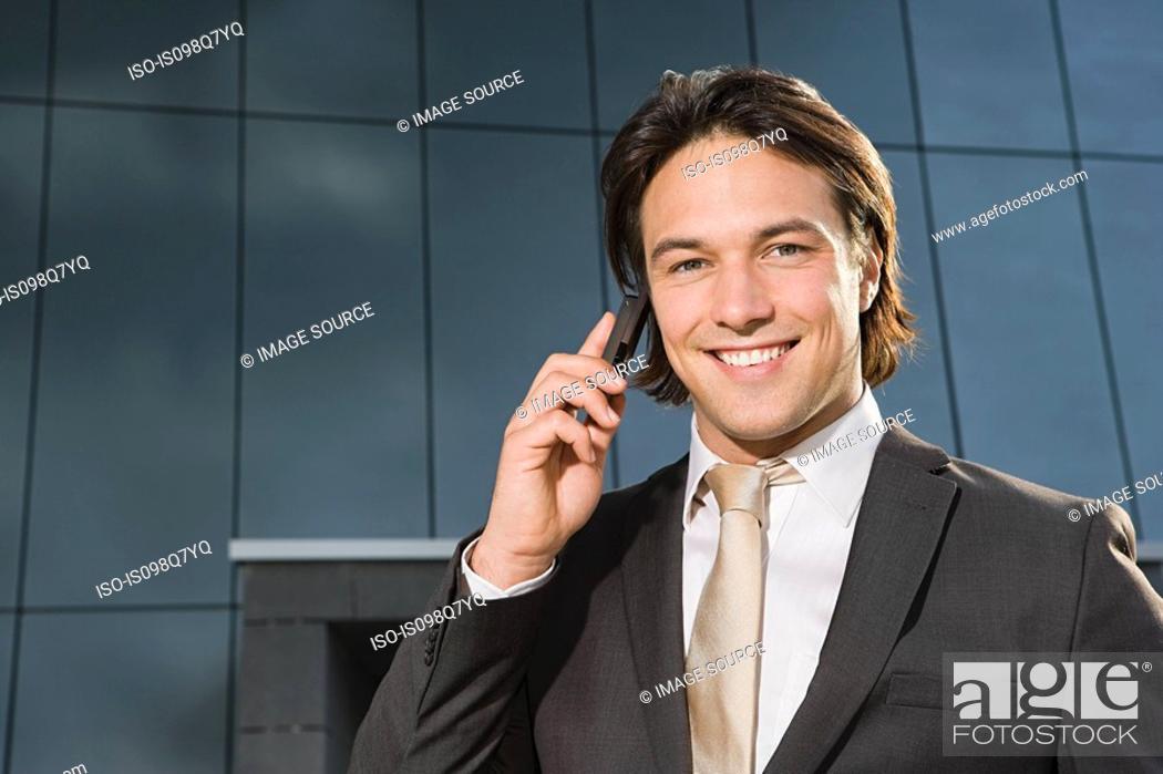 Stock Photo: Businessman on cellphone.