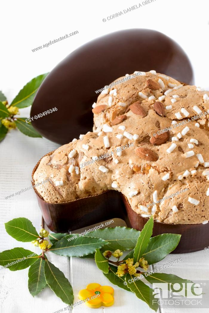 Stock Photo: Colomba pasquale, typical italian sweet for Easter and chocolate egg on white wooden background.