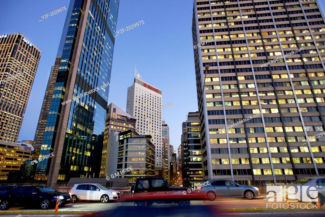 Stock Photo: traffic on Cahill Expressway at dusk with Sydney office buildings in the background.