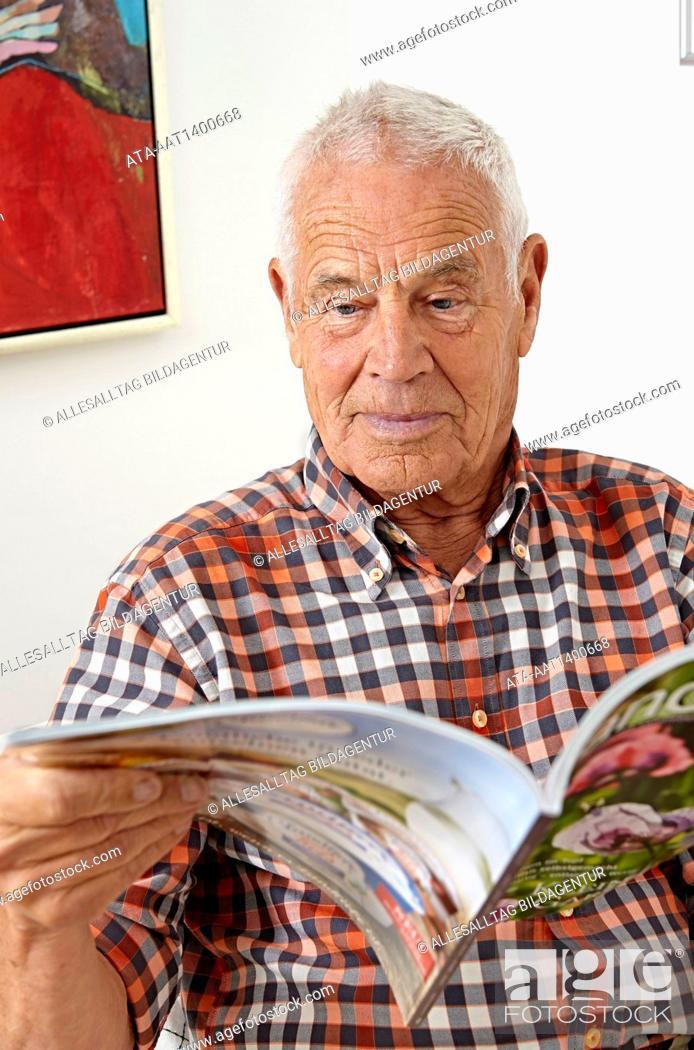Stock Photo: Senior reading a magazine.