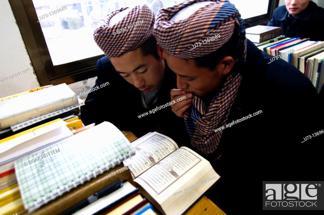 Stock Photo: Hui Muslim boys studying the Qur'an in a Medressa in Gansu province.